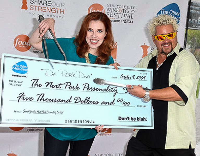 NEW YORK - OCTOBER 09:  Next Pork Personality winner Kristina Vanni (L) receives a check from TV personality and Chef Guy Fieri (R) at a grill-off for the 2009 Food Network NYC Wine & Food Festival at the Norwegian Cruise Line Welcome Center at Pier 54 on October 9, 2009 in New York City.  (Photo by Mike Coppola/FilmMagic) *** Local Caption *** Guy Fieri;Kristina Vanni